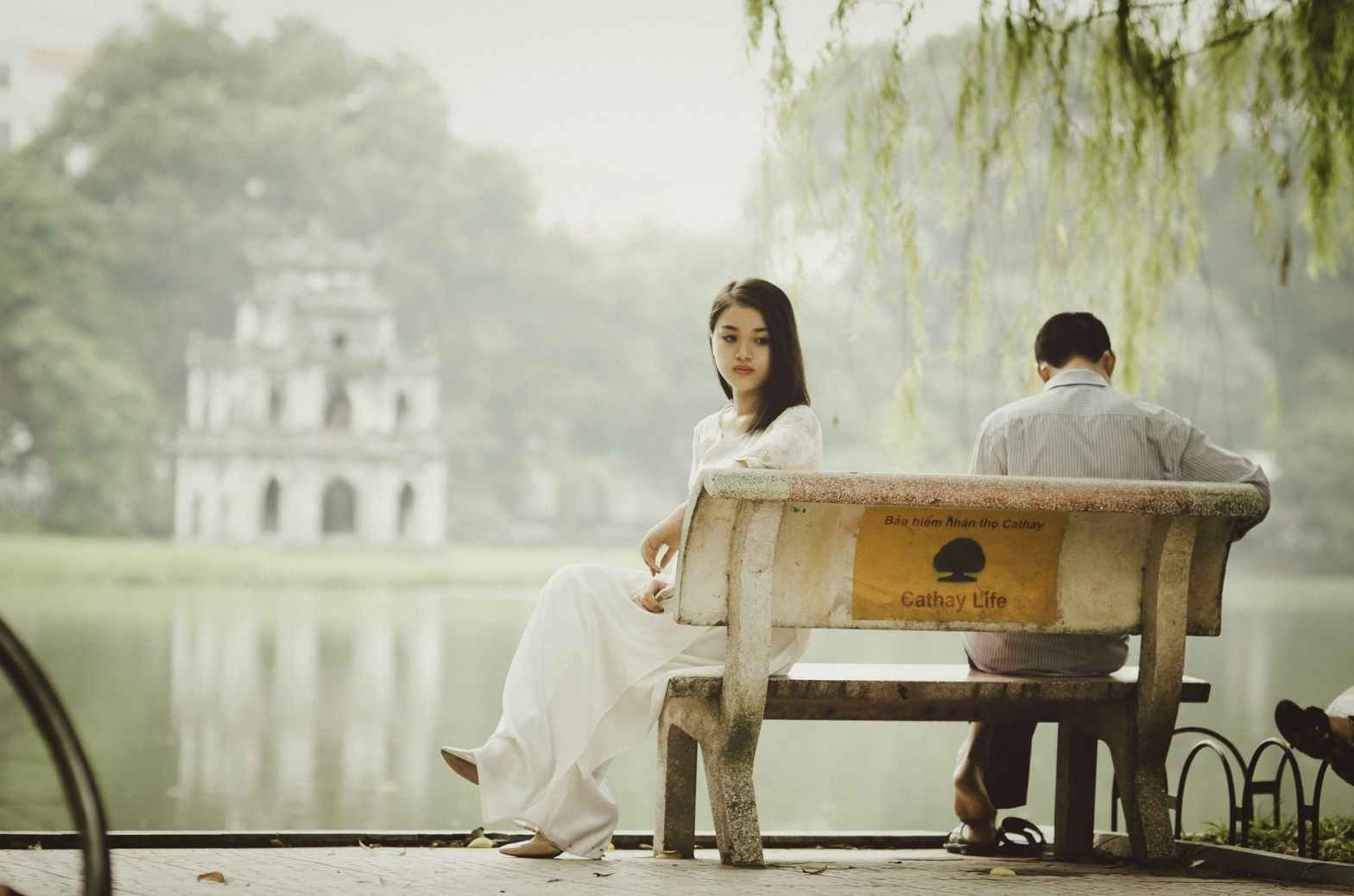 difficult relationship - a couple looking estranged on a bench